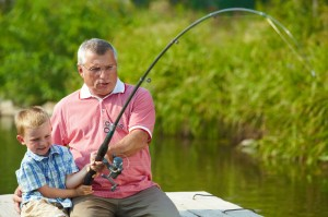 Older gentleman with foster child, fishing